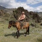 A bare-chested Putin goes horseriding in Siberia during his summer holidays last year. (AP Photo/ RIA Novosti, Alexei Drizhinin, Pool)<span class=