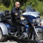 Putin burns rubber on a Harley Davidson Lehman Trike after meeting with bikers at a camp in Ukraine's Crimea peninsula last month.(AP Photo/Alexander Zemlianichenko, Pool)<span class=