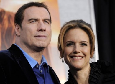 Travolta pictured with his wife Kelly Preston last March.