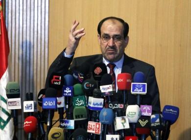Iraqi Prime Minister Nouri al- Maliki speaks to the press in Baghdad in June