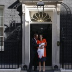 British Prime Minister David Cameron and his wife Samantha pose with their new born daughter Florence Rose Endellion outside 10 Downing Street in London, Friday, Sept. 3, 2010. (AP Photo/Sang Tan)<span class=