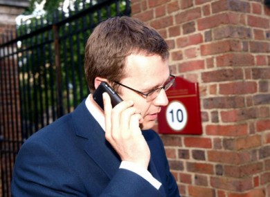 Andy Coulson, one of Cameron's senior aides, on the phone in July, 2010.