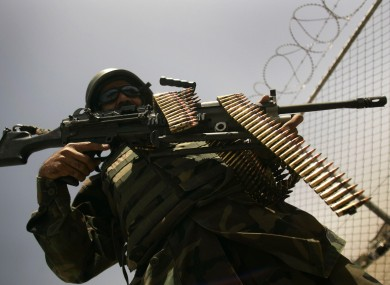 An Afghan army soldier stands guard at a security check point at a military base in Herat, west of Kabul, Afghanistan.