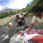Indonesian women was their clothes on a small river as Mount Sinabung is seen in the background in Tanah Karo, North Sumatra, Indonesia, 7 September, 2010. (AP Photo/Binsar Bakkara)