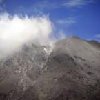 Mount Sinabung spews volcanic smoke as seen from Tanah Karo, North Sumatra, Indonesia, 7 September, 2010. (AP Photo/Binsar Bakkara)