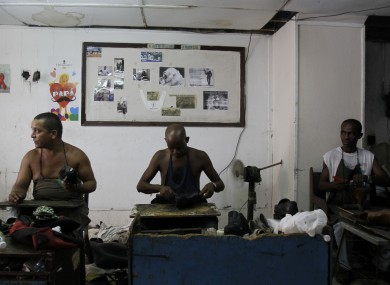 Workers repair shoes in the 'La Habanera' state-owned workshop in Havana, Cuba yseterday.