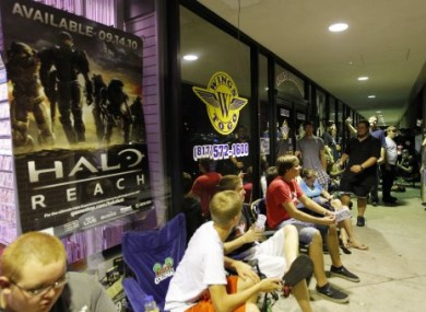 Many video gamers queued up overnight to buy Halo: Reach when it was released on Tuesday morning.