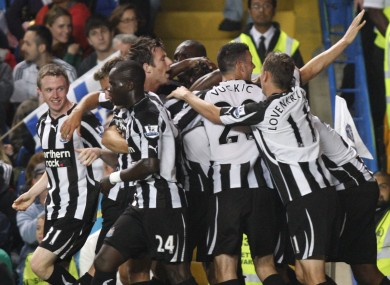 Newcastle United's players celebrates their fourth goal against Chelsea