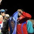 Jimmy Sanchez unfurls the Chilean flag. HUGO INFANTE/GOVERNMENT OF CHILE