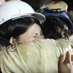 Osman Ayala embraces his wife. HUGO INFANTE/GOVERNMENT OF CHILE