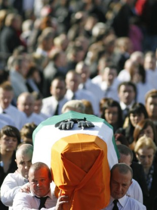 The coffin of Irish Republican John Brady is carried during his funeral in Strabane, Northern Ireland, Thursday Oct. 8,