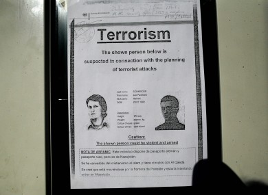 A wanted poster for German citizen Jan Pawlowic Schneider is seen on a door inside the military camp at Kabul airport,