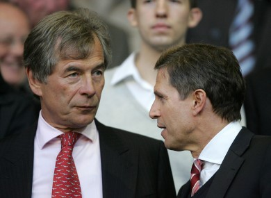 Liverpool chairman Martin Broughton (left) is seeking to stop co-owner Tom Hicks from replacing CEO Christian Purslow (right) on the Board of Directors, and force through the sale of the club.