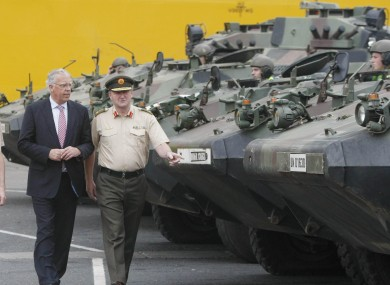 Lieutenant General Sean McCann (right) examines Army equipment returned from Chad with defence minister Tony Killeen (left).