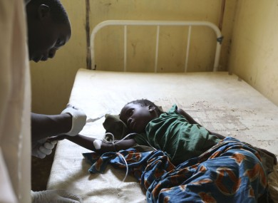 A doctor treats a child suffering from cholera, at a village health clinic in Ganjuwa in Nigeria's rural Bauchi State
