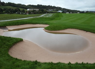 Rain water sits in a bunker on the 2nd hole at Celtic Manor.
