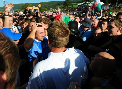 Graeme McDowell is mobbed by fans after his point won the Ryder Cup for Europe.