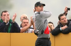 Harrington roars into contention in Malaysia