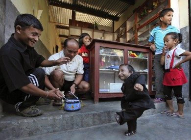 Khagendra Thapa Magar (right) has officially been declared the world's smallest man.