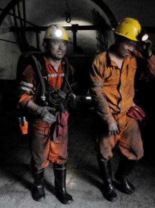Rescuers prepare to go underground after the explosion at the state-run mine in central China.
