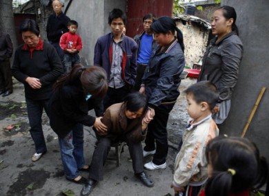 A relative of a miner grieves near the state-run Pingyu Coal & Electric Co. Ltd mine in Yuzhou city, central China's Henan province on Sunday.