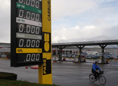 A cyclist passes by a closed petrol station in Caen, western France.