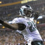 Michael Vick threw for 333 yards and four TDs and ran for two more scores, leading the Philadelphia Eagles to a record-setting 59-28 demolition of rivals the Washington Redskins last night.