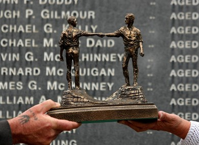 Relatives of the victims of Bloody Sunday hold a statue presented to them by leaders of Northern Ireland's protestant churches.