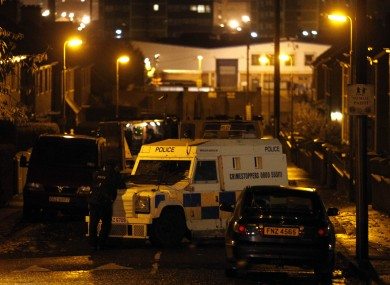 Police at the site of St James Park in West Belfast after a pipe bomb detonated there last night.