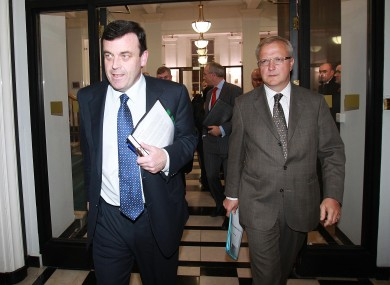 Brian Lenihan and Olli Rehn leave the Department of Finance to address reporters outside last night's meeting.