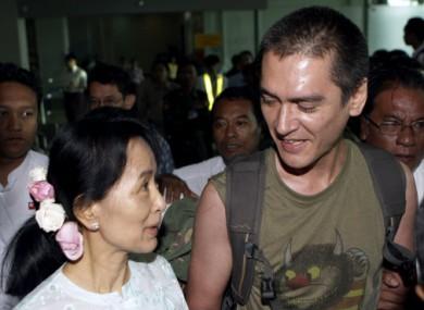 Myanmar's pro-democracy leader Aung San Suu Kyi welcomes her son Kim Aris, at Yangon International Airport today.