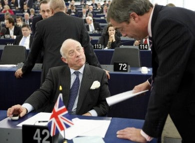 Godfrey Bloom (left) speaks with his UKIP party leader, Nigel Farage, yesterday in the European Parliament before shouting Nazi slogans at a German MEP.