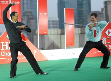 Tiger Woods and Lee Westwood cross swords during the 2010 WGC-HSBC Champions Photocall at the Peninsula Hotel of the Bund in Shanghai today.