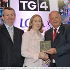 Kerry's Geraldine O'Shea takes her award from Pat Quill, right, President, Cumann Peil Gael na mBan and Pól Ó Gallchoir, TG4 at Croke Park last night.