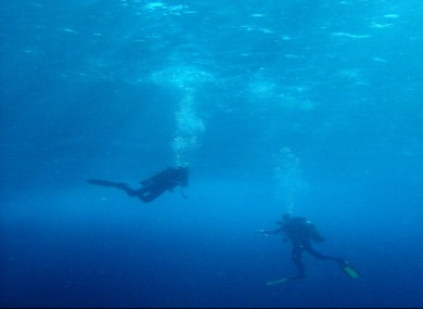 Scuba divers normally dive in company but Mr McCarthy signalled he was staying behind, and didn't resurface