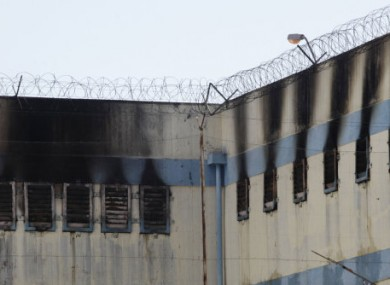 An area of the San Miguel prison is burned after a fire killed at least 81 prisoners in Santiago, Chile, today.
