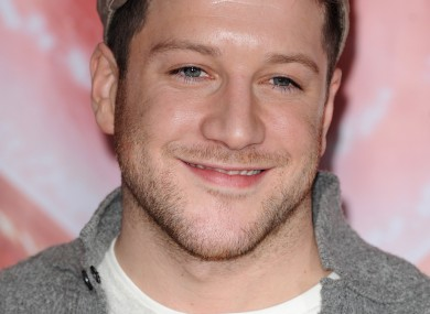Of course Matt Cardle's all smiles - he's almost certain to win this year's X Factor.