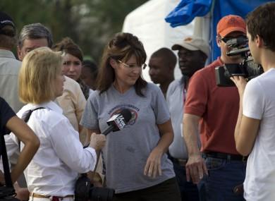 Sarah Palin is interviewed by Fox News's Greta van Susteren during her visit to a cholera treatment centre run by Samaritan's Purse in Cabaret, Haiti.