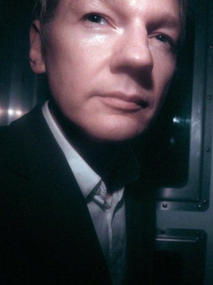 Julian Assange photographed in a police van on 14 December.