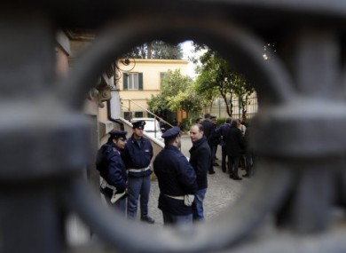 Police officers stand guard outside the Chilean embassy in Rome, the scene of a parcel bomb attack on 23 December, 2010.