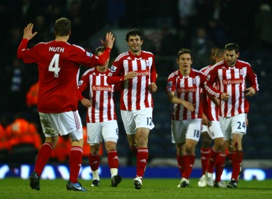 Stoke City's Marc Wilson, centre, celebrates scoring yesterday.