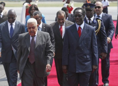 Cape Verde President Pedro Pires, left, walks with Ivory Coast Prime Minister Ake N'gbo on arrival at the airport in Abidjan, yesterday.