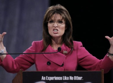 Sarah Palin's personal credit card details and website were hacked after she said Julian Assange had