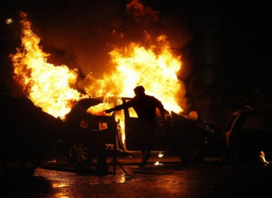 Protesters clash with police in the Ardoyne Road area on 12 July 2010.