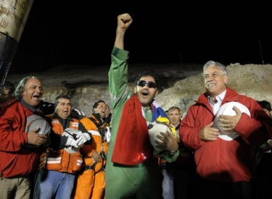 File photo of Luis Urzua (centre), the last of the 33 miners freed from the mine, on 13 October, 2010.