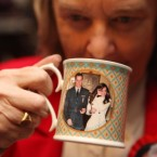 Margaret Tyler drinking a cup of tea in a William and Kate mug as she celebrates the engagement of Prince William and Kate Middleton in the Princess Diana room of her home in Wembley, north London.