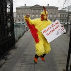 A member of Labour Youth dressed as a chicken makes a political point against Fine Gael Leader Enda Kenny outside Leinster House yesterday. Kenny has been refusing to take part in a three-way leaders' debate with Fianna Fail and Labour, saying that there should be five-way debates to take in the leaders of Sinn Fein and the Greens too.