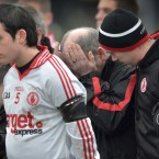 Members of the Tyrone panel comfort manager Mickey Harte during the minute's silence held for his daughter Michaela<span class=