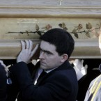 Michaela's brother Mark Harte carries her coffin from her parents' home in Ballygawley, Co Tyrone this morning.<span class=