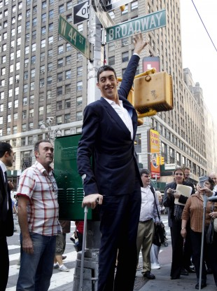 Sultan Kosen, the world's tallest man, can expect plenty of hugs today